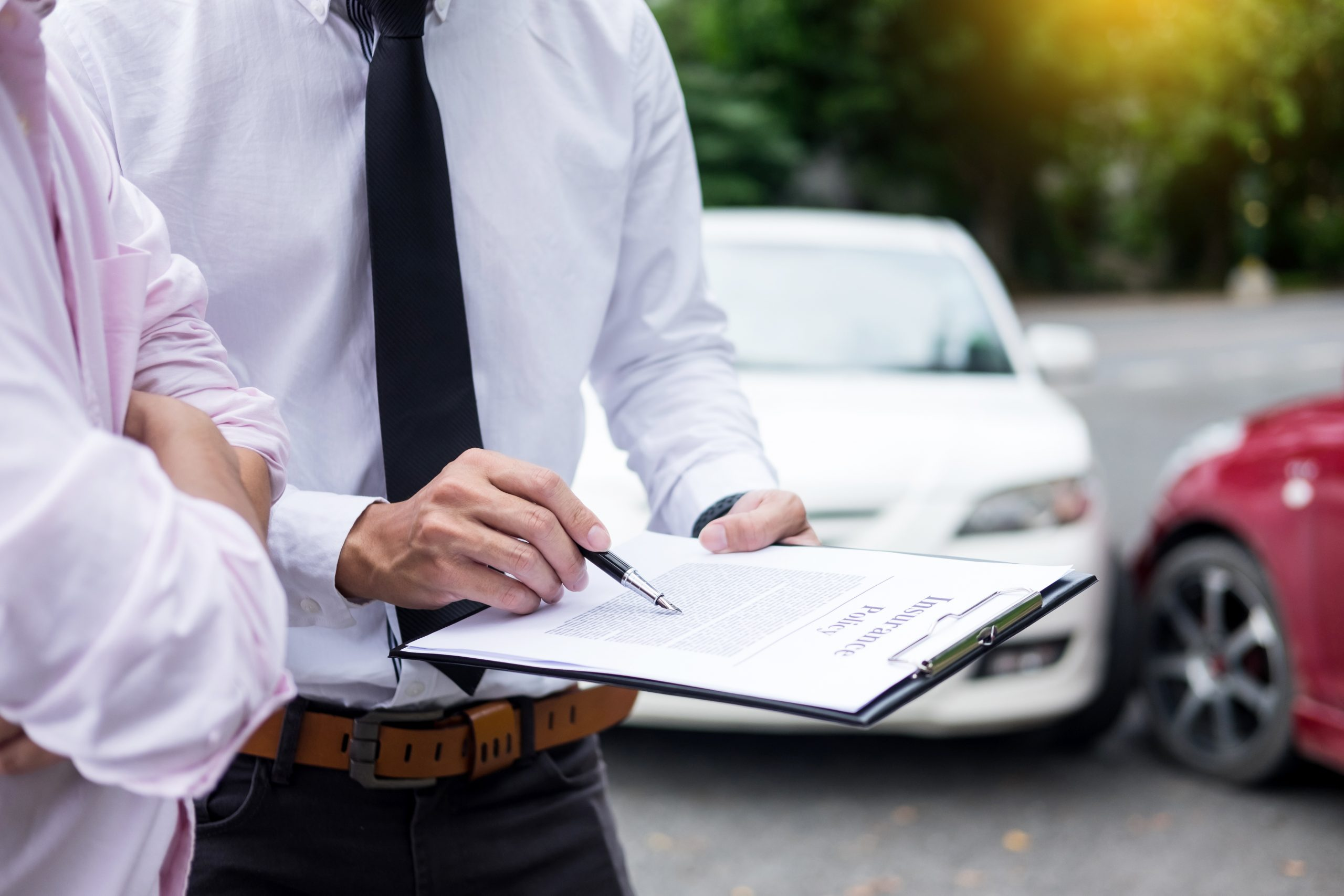 Insurance agent filling out Florida car accident report