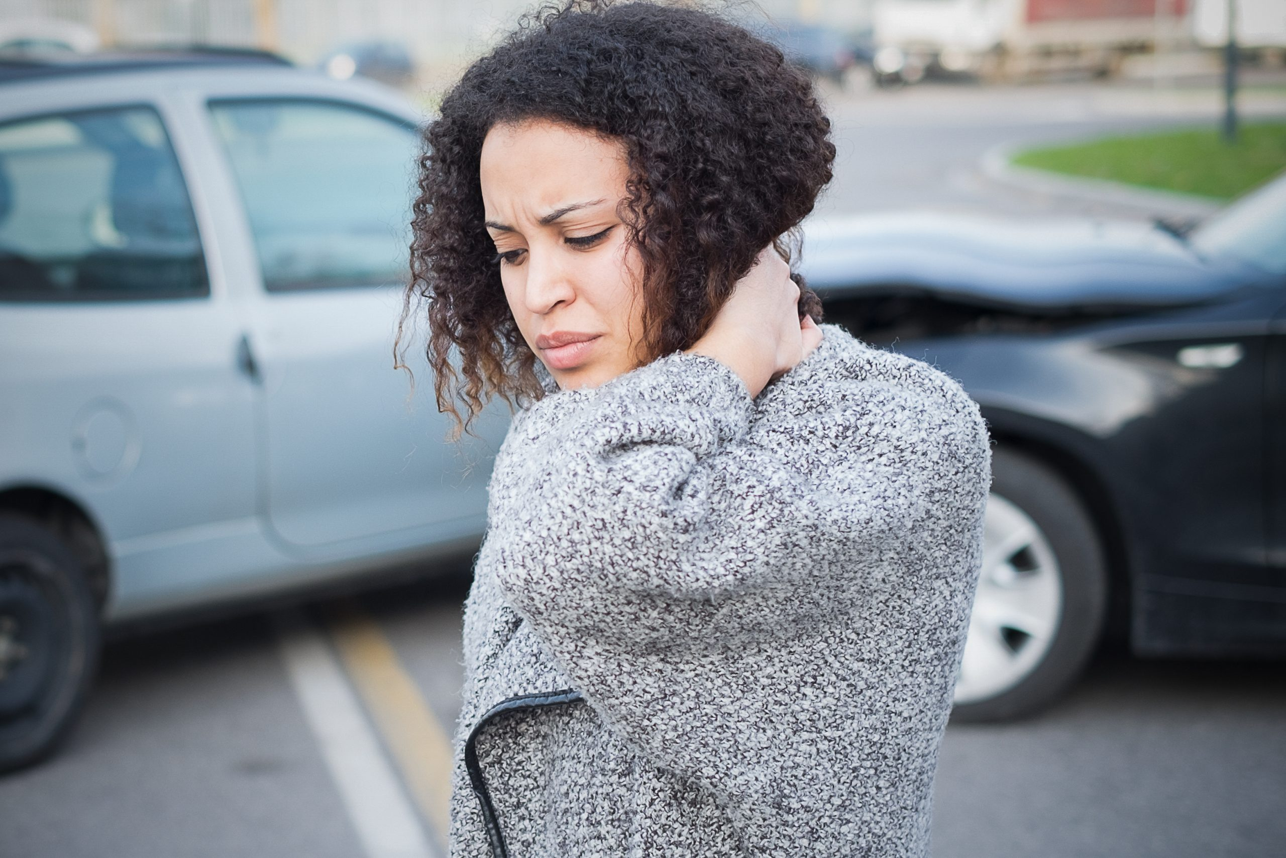 Woman feeling bad from car accident neck injury